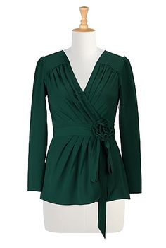This beautiful pine green rosette adorned wrap blouse would be fantastic for the holiday season. #fashion #style #tops
