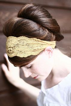 lace headband with a super big bun.