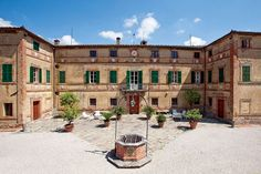 TORRITA DI SIENA, ITALY Dating from the 15th century, this remarkable three-story Tuscan villa graces a 74-acre vineyard property known as Tenuta di Petriolo.