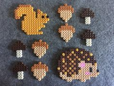 Table Decorations Hedgehog and squirrel made of iron beads # basteln mit kindern igel Perler Bead Designs, Easy Perler Bead Patterns, Melty Bead Patterns, Perler Bead Templates, Hama Beads Design, Diy Perler Beads, Perler Bead Art, Pearler Beads, Beading Patterns