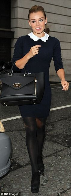 I love Katherine Jenkins' outfit! She's wearing a navy blue dress with a white, scalloped Peter Pan collar, suede boots and a black Willow Mulberry handbag.