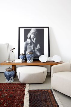 Beautiful bedside table with black and white photograph and white speakers
