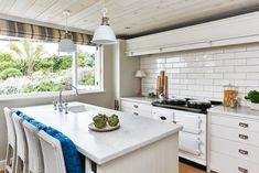 Cottage kitchen features an alcove filled with a black and white Aga Stove flanked by ivory cabinets adorned with vintage hardware as well as a white linear tiled backsplash with black grout. Cottage Kitchen, House Interior, House, Beach House Design, Kitchen, Devol Kitchens, Interior, Kitchen Design, Barn Kitchen