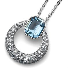 """Stunning Swarovski Pendant made of rhodium plated metal. The first part of the Pendant is a beautiful Rectangle Faceted Blue Swarovski Crystal that measures approx. .5"""" x .25"""", and connects to the Door Knocker like aspect of the pendant."""