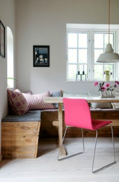 Scandinavian Retreat dining room banquet, pink chair, kitchen table, industrial pendant light