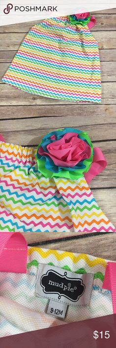 """Mud Pie Rainbow Chevron Top NEW 9-12 Mo Ribbon Mud Pie Rainbow Chevron Top NEW 9-12 Mo Ribbon Flower  So cute!  I believe this is a top and not a dress but check the length as it may work for your LO. Grosgrain ribbon straps and flower. Elastic in the top. 14"""" long not including straps 11.5"""" p to p 100% cotton New, no tag. Mud Pie Shirts & Tops Tank Tops"""