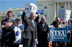 Rep. John Sarbanes, D-Md., left, and House Minority Whip Steny Hoyer, D-Md., participate in the National Treasury Employees Union rally in support of...