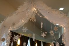 love the feather combo with the snowflakes and tulle