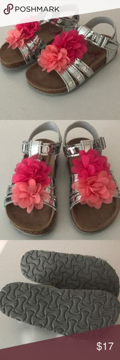 Flower Sandals NWOT! My daughter took the tags off and wore them around the house, but they are too small :( super cute!! Shoes Sandals & Flip Flops