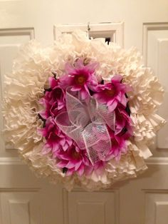 A coffee filter wreath with Silk flowers and a deco mesh bow-- Ideal for Spring