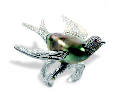 Ring in 18k gold with 14.6 mm by 24 mm baroque black Tahitian pearl with 1.4 cts. t.w. diamonds, $8,000; Emiko Pearl