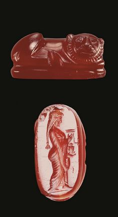 A GRECO-PERSIAN CARNELIAN LION GEM   CIRCA LATE 5TH-4TH CENTURY B.C.   The lion reclining on a plinth with his head turned to his right, resting on his forepaws, a radiating hatched mane framing his face, chevron at the top of the head; the underside engraved with a Persian woman standing in profile, wearing a long loose-sleeved garment, her hair arranged in a long braid with a triple-knobbed terminal, holding an ointment jar in one hand, the lid and a dipper in the other, on a short…