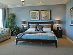 Clear Blue Bedroom: This bedroom's palette gives a nod to earth and sky, with walls painted in a clear blue that's echoed in the quilted coverlet and shams. Earth tones come into play with the bed, accent tables, lamp shades, frames and accent pillows. From HGTVRemodels.com