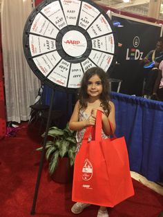 Brought my future @AARP member to our #OhioStateFair booth last night after #KidzBop. She had some fun with the prize wheel! @AARPOhio -- Read more about the Prize Wheel at https://PrizeWheel.com/blog/.