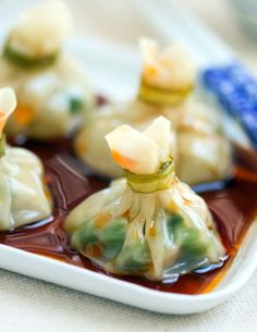Elegant pouches are one of the easiest dumpling shapes to make at home. These dim sum have shrimp and asparagus hidden inside.