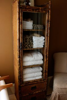 This faux bamboo cabinet is currently my favorite piece of furniture. It lives in the master bathroom, doing duty as a storage piece for ou...
