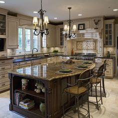 Love how the island has different colored cabinets and countertop from the rest of the kitchen.
