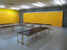 Yellow Metal Lockers and Mahogany Benches in gym changing rooms