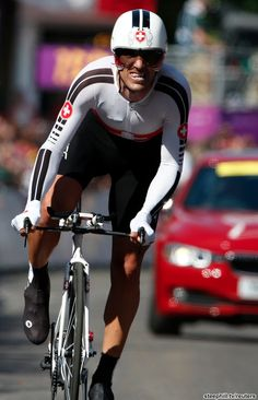 The defending Olympic Men's TT champ was hampered by an injured elbow sustained during the road race several days ago. Fabian Cancellara finished 7th +2:15.