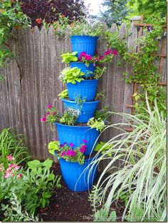 How To Recycle Planting Containers Into A Planting Tower. Love the blue