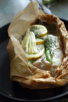 Baked halibut with asparagus, leeks and dill.