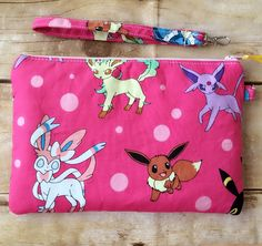 Pokemon wristlet purse, zippered wristlet pouch, evolution of Eevee by PopThree on Etsy https://www.etsy.com/listing/469695465/pokemon-wristlet-purse-zippered-wristlet