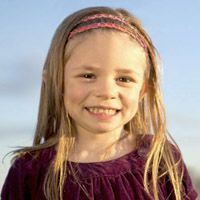 Shayna, who was born with hearing loss, is learning to read and speak at the Central Institute for the Deaf, one of our partner agencies.