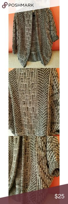 Cardigan Look stylish and feel cozy in this super cute cardi, cable-knit, excellent condition, Has two Front hidden pockets, Sleeves are not fully long, roll them up for a cute look, 71% Acrylic, 29% Wool Sweaters Cardigans