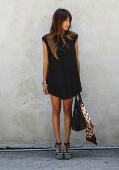 I love wearing black all year long. In fact, I am wearing a black dress as I write this, and it's about 80 degrees outside. I do try to wear a little more white and color in the summer, but my black d