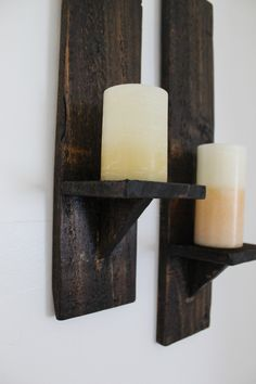 DIY Pallet Wood Candle Sconces | amandakatherine.com This is an easy project you can do with just a few supplies laying around the garage! Perfect for that blank wall in your home where you never knew what to hang.
