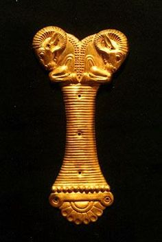 Achaemenid golden piece simillar to the handle of a dagger.  Reza Abbasi Museum  Tehran,Iran