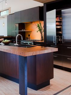 Modern Kitchen Design | Gardner Mohr Architects | Kitchen with wood countertops, dark cabinets, zen type design