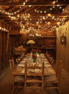 Drape string lights from rafters to decorate for your dinner party.