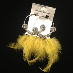 POParazzi style is everywhere! Even with these feathered earrings! Only $4