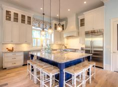 I'd change the navy out foran aqua but love the square island with stools. House of Turquoise: Borges Brooks Builders