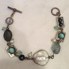 Hand crafted artist bracelet A beautiful handcrafted bracelet! In very good shape with beautiful blue and green beads, stones, and metals Vintage Jewelry Bracelets