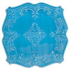"""Ceramic salad plate with scrolling detail.   Product: Salad plateConstruction Material: CeramicColor: Turquoise Features: Elegant scroll motifDimensions: 1"""" H x 8"""" W x 8"""" DCleaning and Care: Dishwasher safe"""