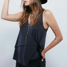 Free People Babe Town Tank Easy, soft wrap sleeveless top featuring strappy grosgrain ribbon ties and v-neck. Sexy t-cross straps on back. Brand new, never worn. Black color.  Reasonable offers welcome! Free People Tops Tank Tops