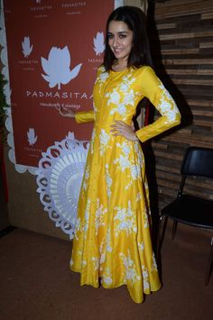 The beautiful actress Shraddha Kapoor who is high on success after her film ABCD 2 attended the IMC Exhibition. Looking trendy and chic the diva wore a bright yellow long outfit.   Source: Business of