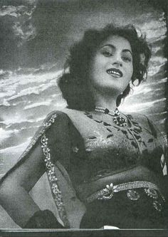 Classical Bollywood actor Madhubala wearing a pearl necklace in the movie Basant, 1942 (exdesi.com)