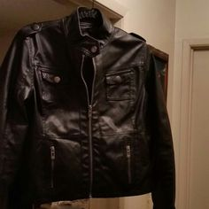 Black pleather zipper jacket Black pleather zipper jacket.  Wore once. 2 top small pockets. 2 lower zipper pockets. Shell 100% polyurethane with 100% rayon woven backing lining. 100% polyester. New Look Jackets & Coats