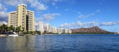 Hotel reflections and Diamond Head crater at Waikiki Beach.