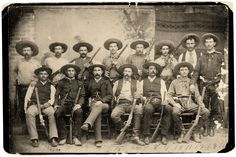 TEXAS RANGERS — (Standing from left) Jim King, Bass Outlaw, Riley Boston, Charley Fusselman, Tink Durbin, Ernest Rogers, Charles Barton and Walter Jones. (Seated, from left) Bob Bell, Cal Aten, Captain Frank Jones, J. Walter Durbin, Jim Robinson and Frank L. Schmid. – Courtesy Texas Ranger Research Center; Texas Ranger Hall of Fame & Museum —