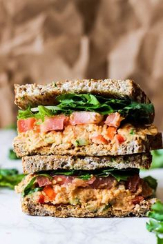 This Vegan Buffalo Chickpea Salad Sandwich is the perfect lunch to pack for adults or kids! It's full of vegetables, beans and grains to keep you satisfied. Try it for a healthy lunch! Vegan Sandwich Recipes, Chicken Sandwich Recipes, Healthy Sandwiches, Vegetarian Recipes, Healthy Recipes, Sandwich Fillings, Chickpea Recipes, Tofu Recipes, Burger Recipes