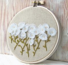 White flowers and hand embroidery wall hanging