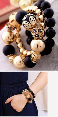 Black Pearls and Gold Charms Bracelet.
