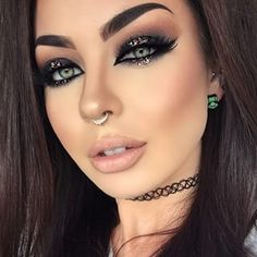 This looks airbrushed or something but she's beautiful and has a cool makeup style