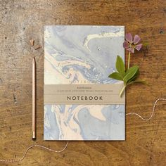 Marbled notebook with gold foiled 'Notebook' on the front cover. Each notebook contains 32 faintly lined 120gsm paper pages. Proudly made in England.
