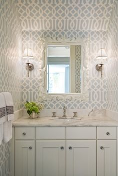 Love this bold wallpaper, stunning in the pale blue adding interest to this gorgeous bathroom. Love the white mirror. It is called Imperial Trellis by Kelly Wearstler