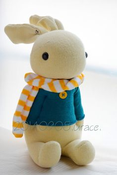 sock rabbit  after stuffing the body, pinch the sides of the body where the arms will be and stitch from front to back to form the arms